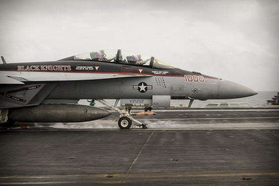 """GULF OF OMAN (Aug. 28, 2013) -- Capt. Kevin Mannix, commander, Carrier Air Wing (CVW) 11, right, and Capt. Rob Osterhoudt, deputy commander, CVW 11 launch from the flight deck of the aircraft carrier USS Nimitz (CVN 68) in an F/A-18F Super Hornet assigned to the """"Black Knights"""" of Strike Fighter Squadron (VFA) 154. Osterhoudt completed his 1,000th carrier arrested landing, or """"trap"""", aboard Nimitz Aug. 28. Nimitz Strike Group is deployed to the U.S. 5th Fleet area of responsibility…"""