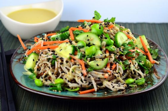 Combine soba noodles, carrots, edamame and cucumbers to make this dish.