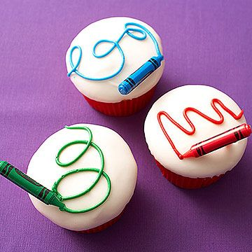 What an artsy birthday dessert! Pipe scribbles onto cupcakes, then add a crayon toothpick.
