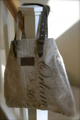 Recycled canvas tote, leather straps & blue ticking interior. And it says 'Orleans.' Of course! $68