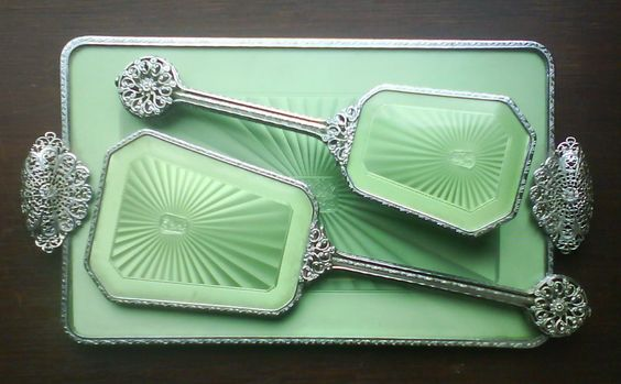 This is a very elegant 1930's vintage silver tone metal dressing table vanity set, with plastic Art Deco green faux enamelled guilloche backs.