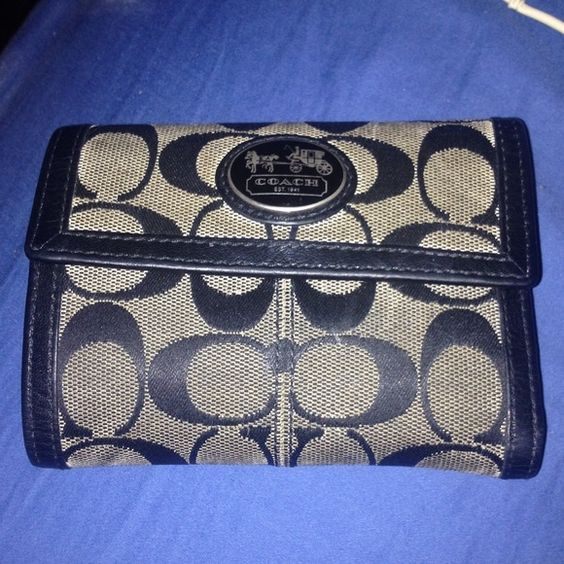 Authentic Coach Wallet This wallet is very roomy with lots of space for your necessities. Features 6 slots for cards, a clear slot for an ID, 5 slots behind the card holders to store receipts or other important papers, a large area for bills, and a zippered coin compartment. Wallet folds and buttons closed. The exterior has an all over Coach logo print in black and gray trimmed with leather. The inside is leather with silver pinstripes at the opening of each card slot. Comment with…