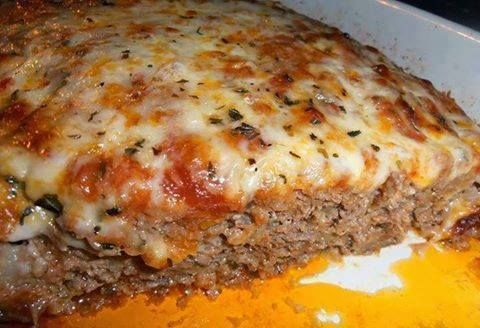 1 lb. ground beef 1/2 lb. ground mild Italian sausage 1 small onion, finely chopped 1/2 C. chopped bell pepper  1 tsp. olive oil 1 tsp. Worcestershire sauce 1 clove garlic, minced 1/2 tsp. oregano 1/2 tsp. basil 1/2 tsp. parsley 1 egg, beaten 3/4 C. Italian bread crumbs 2 slices white bread, crumbled 1 T. milk 8 oz. shredded mozzarella cheese, reserve 3/4 C. for topping 1/4 C. parmesan cheese 1 C. marinara sauce, plus 1/2 -3/4 C. more for topping  http://77easyrecipes.com/italian-meatloaf/
