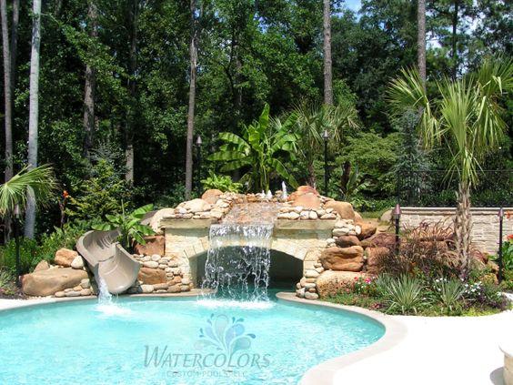 Fancy stone inground pool water slide freeform inground for Pool placement in yard