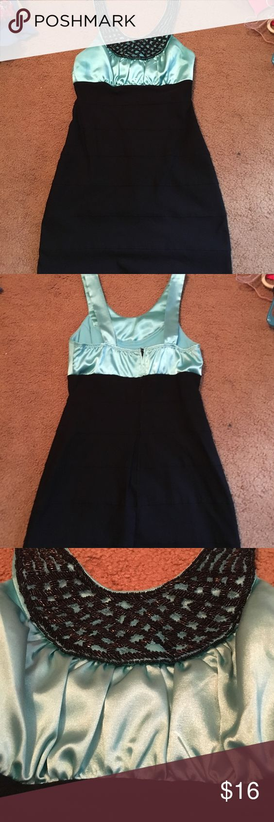 Extremely flattering blueblack fitted dress