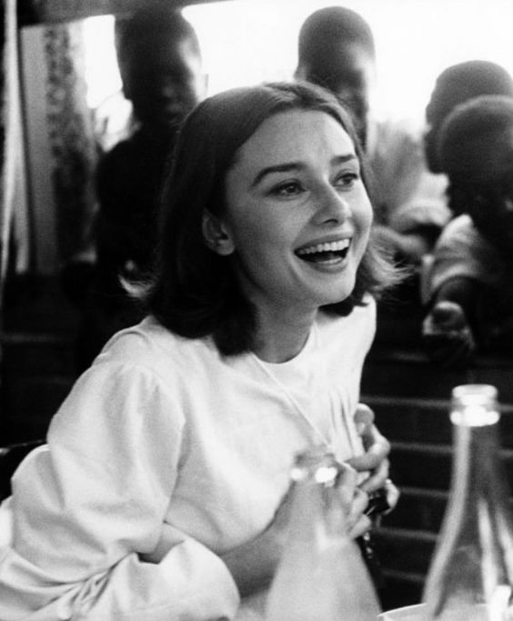 Audrey Hepburn at a restaurant in the Belgian Congo during the filming of The Nun's Story, 1958. Photo by Leo Fuchs