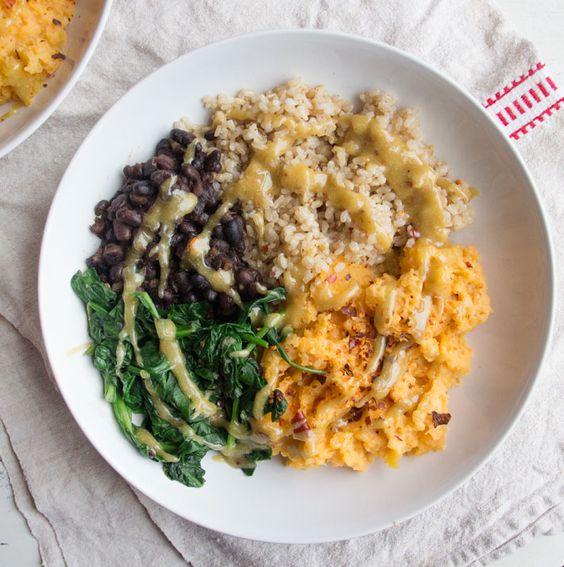 Rejuvinating bowl with sweet potato, brown rice, black beans, spinach, tahini, garlic & lemon
