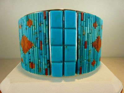 Raised inlay turquoise and orange spiny oyster sterling silver cuff bracelet. The inside of the cuff is also inlaid with opalesque white and yellow mother of pearl. Handmade by David Freeland Jr.