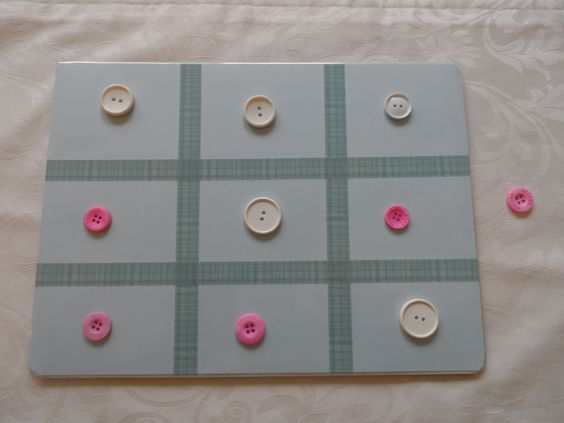 an old tablemat, paper and washi tape for a simple noughts and crosses for kids..