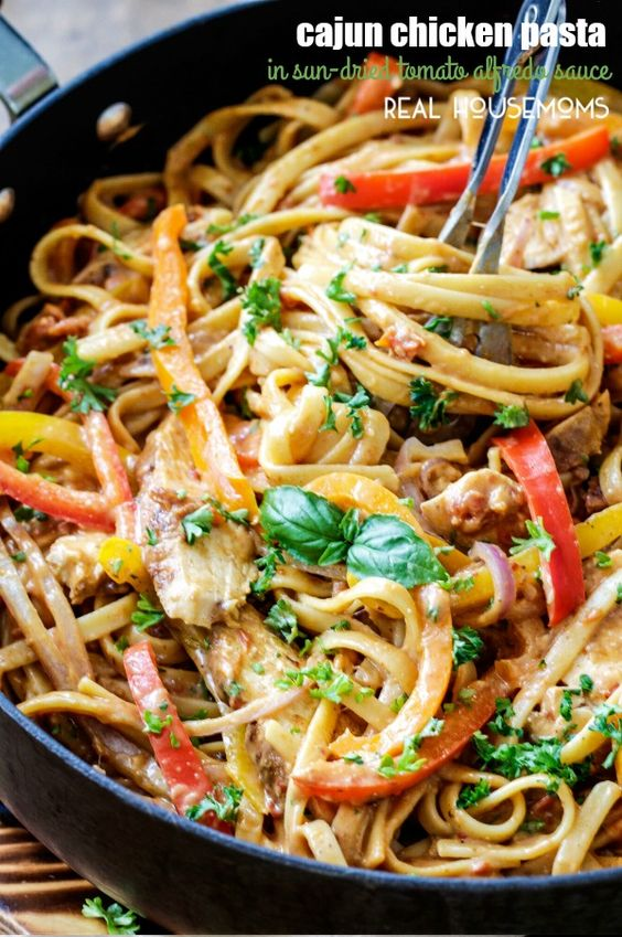 Creamy, CAJUN CHICKEN PASTA IN SUN-DRIED TOMATO ALFREDO SAUCE is melt in your mouth delicious and 1,000x better than any restaurant at a fraction of the cost and calories! by Carlsbad Cravings on Real Housemoms