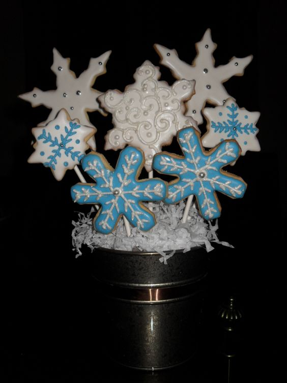 Snowflake sugar cookie bouquet.  Individually hand decorated so no two are exactly alike.
