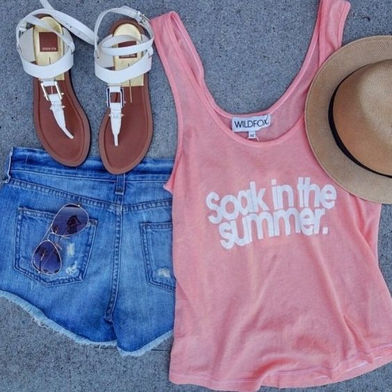"""Wildfox Summer Tank Super cute coral Wildfox tank. Says """"soak in the summer"""" on the front. Just been sitting in my closet, too cute to not be worn. Hoping someone can get good use out of this. Fits true to size, relaxed loose fit. Reasonable offers can be made using offer button  1st pic credit to @nordstrom Instagram   Condition: Brand new, never worn.  Trades  Please ask any questions prior to purchasing. All sales final. Wildfox Tops Tank Tops"""