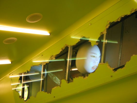 Seattle Public Library: Installation by Tony Oursler located within the walls of the escalator connecting levels 3 and 5.