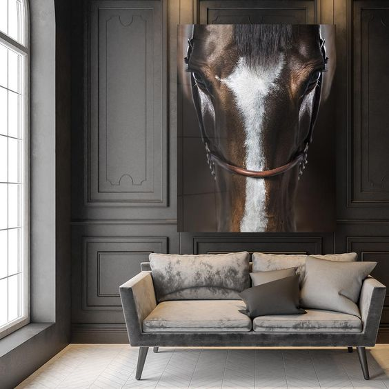 Black painted paneled wall in a Paris apartment living room with huge horse painting or photo