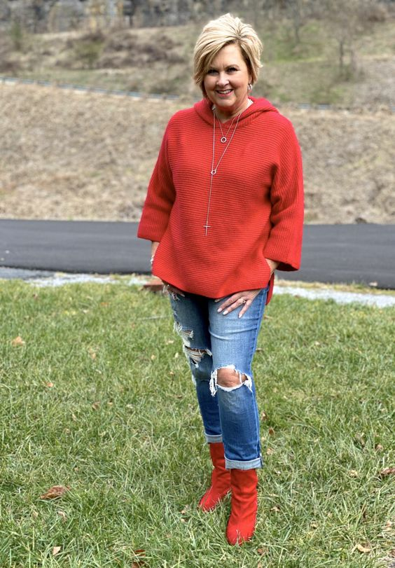 Bold colors for the Holidays include RED! Check out the adorable boots and sweater @50isnotold #Christmascolors #Holidaystyle #fashionover40 #ankleboots #distressedjeans
