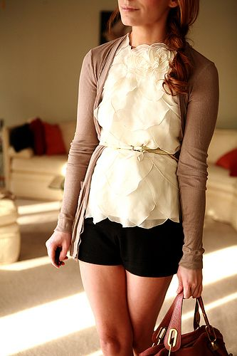 Ruffled blouse, with skinny belt, cardigan and shorts. Be super cute with summer wedges!