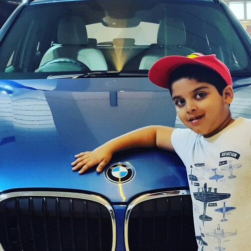 Champ with his dream machines: With the all - new BMW X1 at IGI T2.