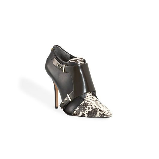 Rachel Roy: Point toe bootie with snake detail on pointy toe and side hardware details.
