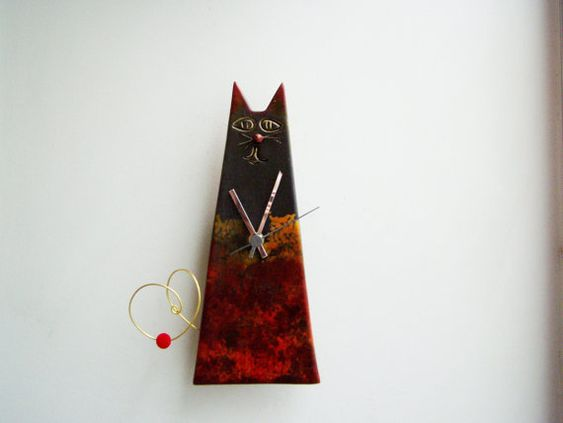 Black cat clock, ceramic wall clock of cat with black head and dark coloured body, cone shaped cat clock, sitting cat clock, office decor