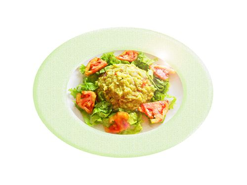 Guacamole con tomate y cilantro.  El guacamole sin picante es un aperitivo suave que puede comer cualquier persona. Es una fuente de vitaminas, minerales y grasas sanas.