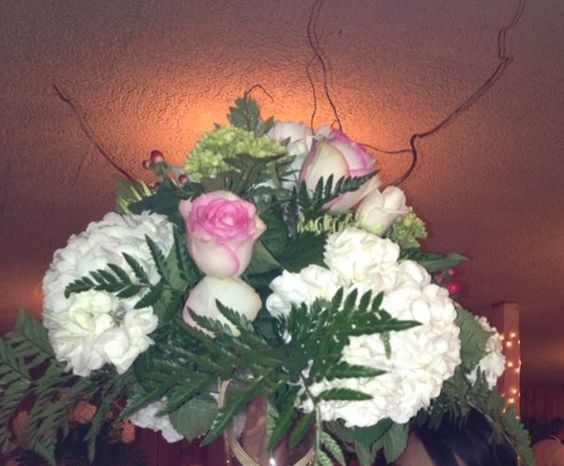 centerpiece on top of a tall vase...