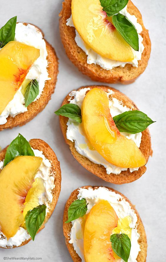 The perfect summer bruschetta recipe made with fresh peaches, goat cheese and fresh basil.
