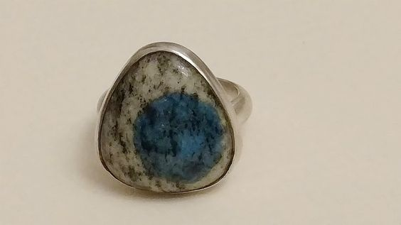 old blue eye 20mm rounded edge triangle shaped cabochon K2 stone set in sterling silver.  Size 6.5.  $88