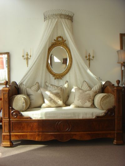 French country antique Louis Philippe bed with contempary French fabrics and antique French Louis XVI mirror: