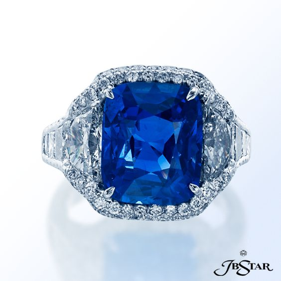 JB Star Platinum diamond ring featuring a beautiful cushion diamond center stone with trapezoid and princess diamonds and edged in micro pave.
