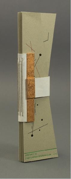 The backplate extends to form a clasp around the textblock, with rare earth magnets sandwiched between panels of board covered in copper col...