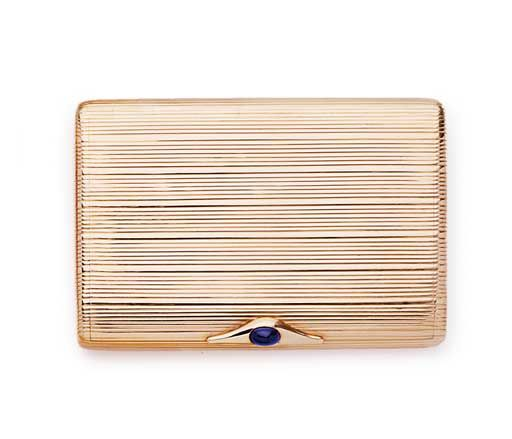 A RUSSIAN GOLD CIGARETTE-CASE MARK OF ANDREI BRAGIN, ST. PETERSBURG, 1908-1917 Oblong, with reeded cover, sides and base, the hinged cover with a cabochon sapphire thumbpiece, marked inside base. FROM THE COLLECTION OF KING GEORGE I OF THE HELLENES. Christie's.