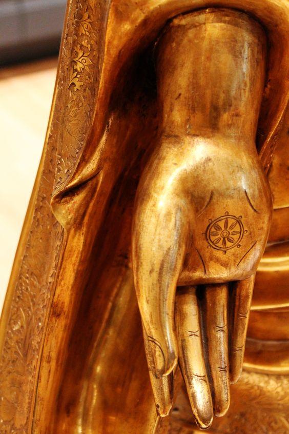 Buddha hand, wheel of Dharma