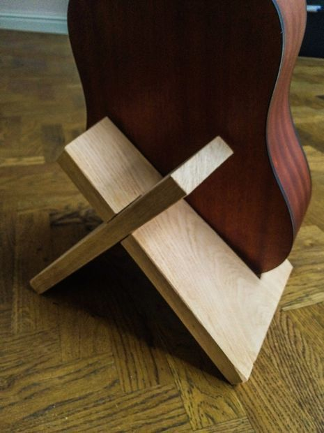 I designed this guitar stand to be universal and really simple: no glue no screws no nails just one piece of wood.In this case I used a board of oak wood, 25mm thick, about 22 cm wide and about 38 cm long.You can use the template I made and modify it to change the size. I found that a corner of 9º works best on all acoustic guitars, I haven't tried an electric guitar yet tho.If you decide to make your own I would love it if you'd send me a picture of it at stand@lennartdemeij.com