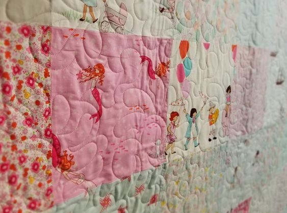 I just adore this sweet baby quilt! A 9 year old patched it and we quilted it with this Feather Delight design. She chose such delightful fabric!  From soft baby blankets, to cozy Christmas presents we love to help make your quilting dreams come true! Come to our website to see more designs we offer. Sign up for our email and you'll recieve 15% off your first order and a free pattern.