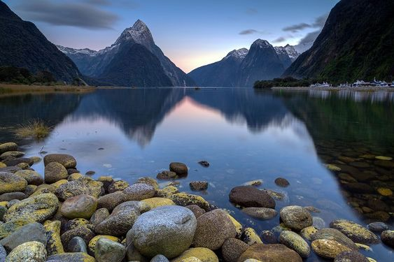 In A Faraway Land - Mitre Peak reflecting in bay of Milford
