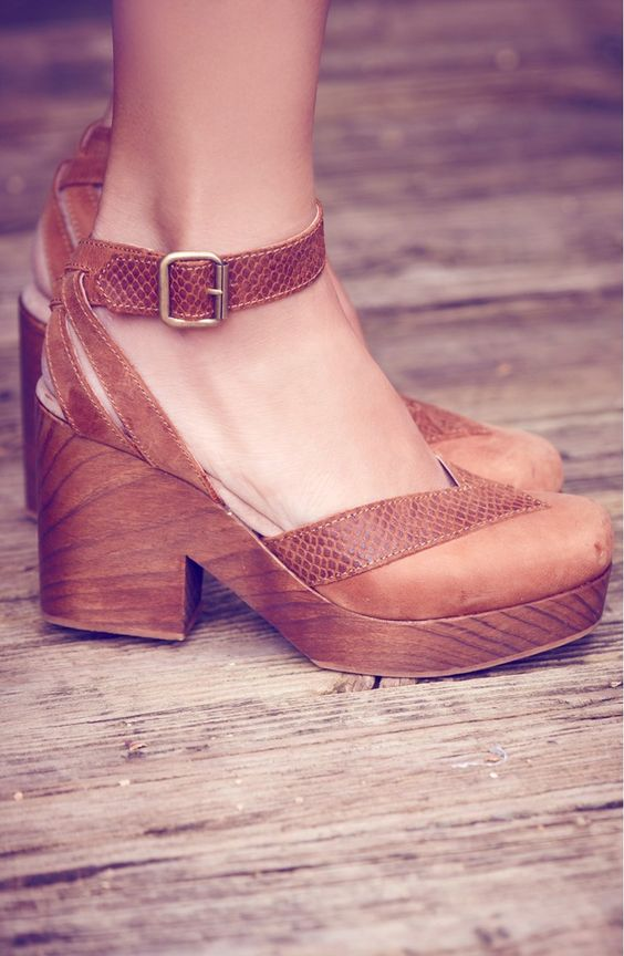 This retro-inspired leather clog sandal from Free People is detailed with textured trim and lifted by a wooden platform and chunky heel.