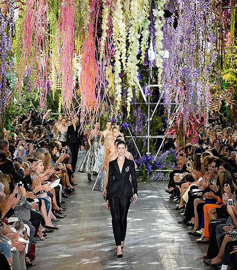 "@Who What Wear - Christian Dior S/S 2014                  Location: Musee Rodin in Paris, France  As the backdrop for his S/S 14 show for Dior, Raf Simons commissioned a tropical hanging garden to festoon the venue. Combinations of thousands of square meters of real and fake neon vines, wisteria and roses were attached to the ceiling and walls of the Musee Rodin venue. He described the scenery as the ""experimental habitat of the new flower woman"" and unsurprisingly, the strands of flowers…"