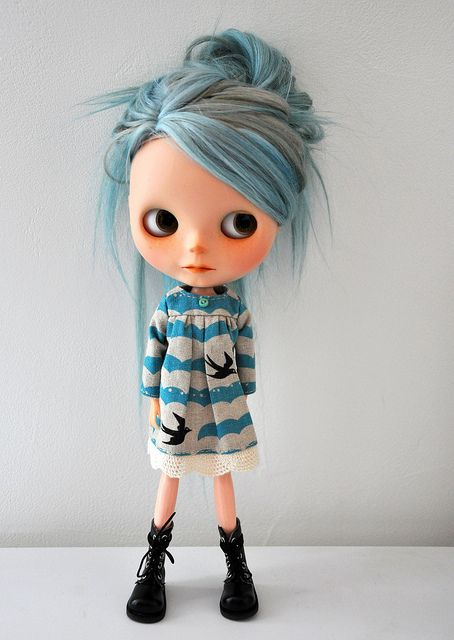 I love the colour of her hair and dress because it  helps me give an idea how old she is, along with the natural look on the doll and style of dressing. I think she could be about fourteen or slightly younger.
