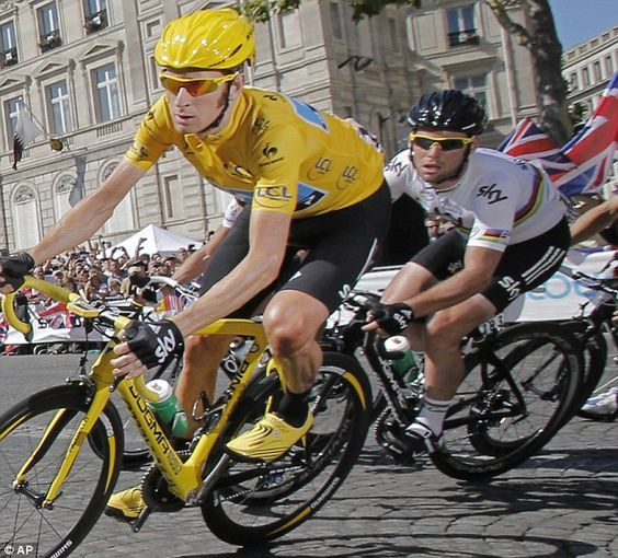 Road to victory: Bradley Wiggins on his way to winning the Tour de France with Mark Cavendish the stage winner close behind him