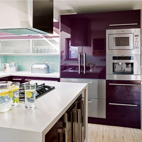 Love this gorgeous colour block kitchen! Stunning purple appliances and that gorgeous kitchen island.