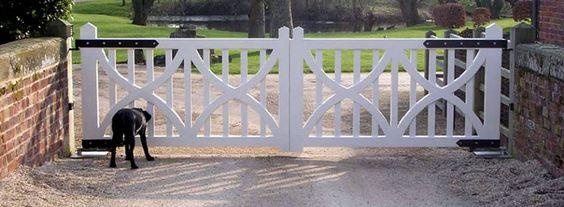 Open white driveway gates