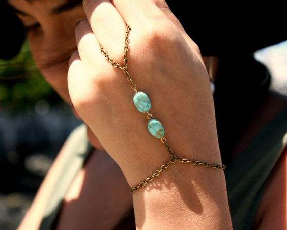 Two turquoise beads hand jewelry