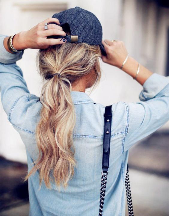 low ponytail hairstyle for curly blonde long hair