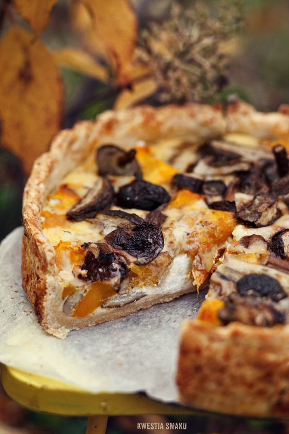 Quiche with roasted mushrooms and roasted pumpkin  with goat cheese and a crispy parmesan crust. (Translates from Polish)