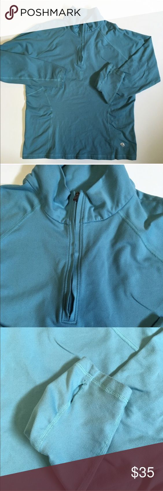 "Mountain Hard Wear Blue Pullover Quarter Zip Light turquoise blue quarter zip pullover. Thumbholes at sleeve ends. Lightweight polyester/Elastane fabric. About 42"" at bust, unstretched, and 25"" from shoulder to bottom hem. Mountain Hard Wear Jackets & Coats"