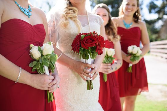 Love these bouquets! Red flowers to match the bridesmaid dresses and white to match the wedding dress!