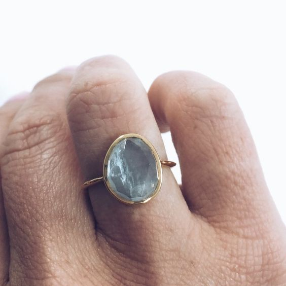 A rose cut aquamarine stone is organically bezel set on a 14K yellow gold vermeil band. A classic and timeless ring featuring a semi-precious stone that never goes out of style! - Aquamarine - 14K yel
