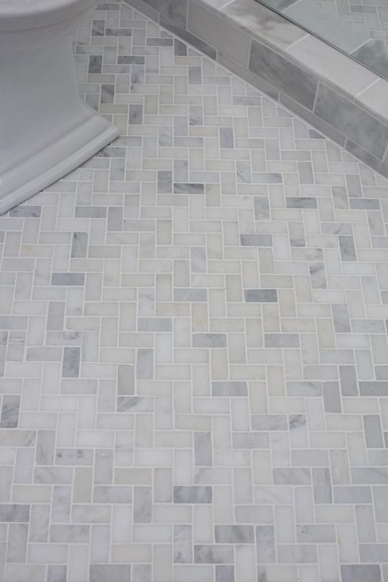 Guest bathroom reveal bathroom floor tiles herringbone for Small bathroom herringbone tile