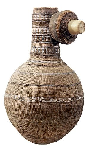 IGBO GOURD , Nigeria These containers are made from gourds, with a woven surface interlaced with thin metal wire. The white piece protruding from the cap is plastic.
