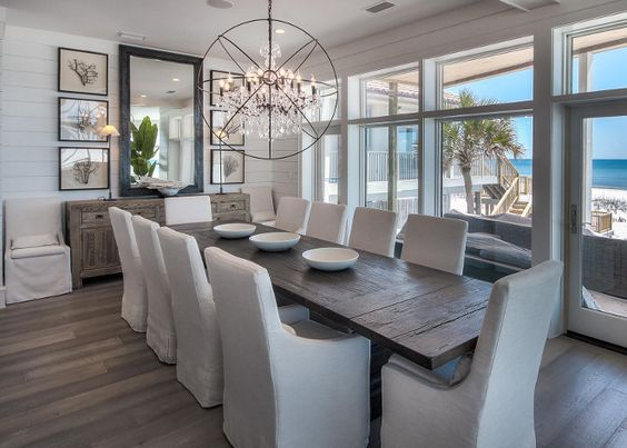 Long rustic table for large gatherings, floor-to-ceiling windows